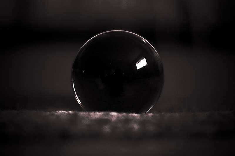 A glass orb refracting nearly solid black.
