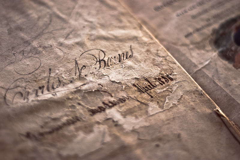 A signature inside the cover of a 150-year-old book.