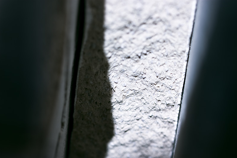 A macro image of the broken edge of a kiln shelf.