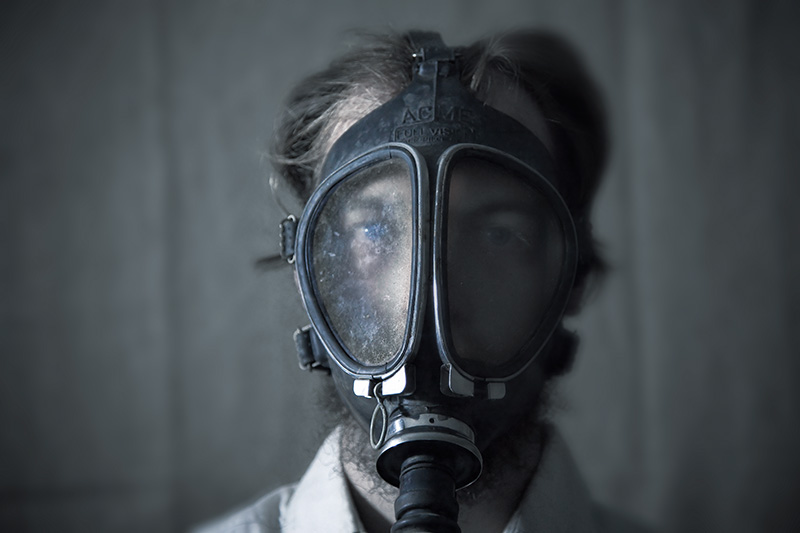 A self-portrait while wearing a gas mask.