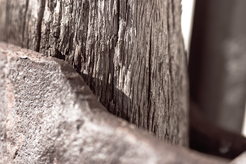 Old, weathered wood and metal.