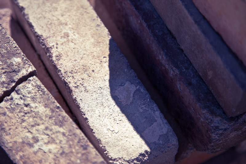 Stacked bricks, one of them broken.