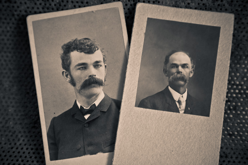 A pair of photographs of a man with a giant mustache, one when he is young, the other when he is old.