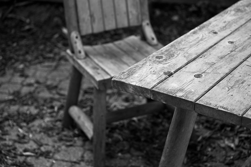 A weathered wooden table and chair.