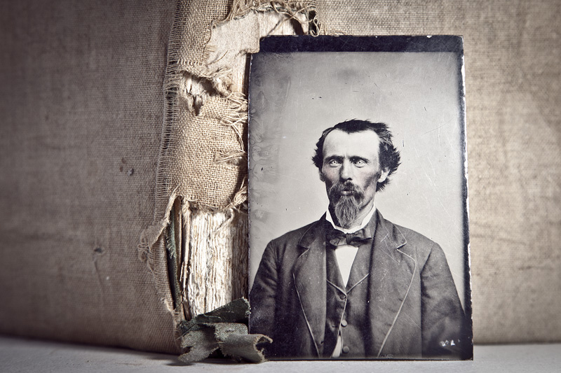 A tintype portrait of a man with crazy eyes.