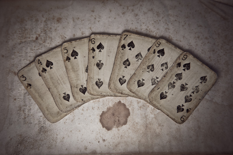 Very old miniature cards, showing the 3 of spades through the 9 of spades.