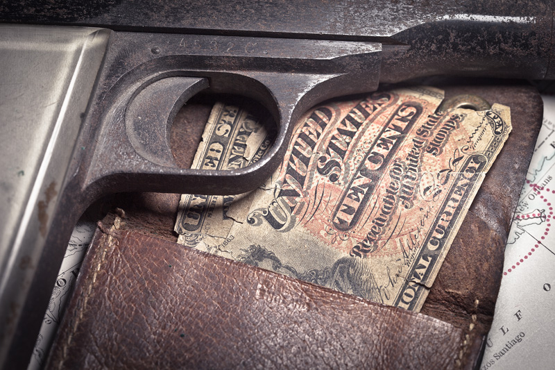 A gun, a map and a coinpurse containing thirty five cents in paper money.