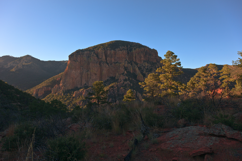 Evening sunlight against a peak in the Chiricahua Mountains, viewed from the Red Rocks along the Burro Trail.