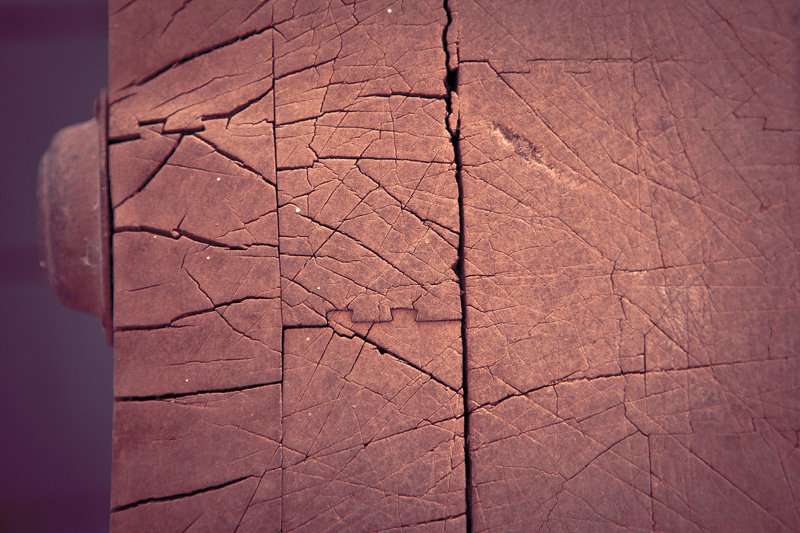 The surface of an old, weathered, well-used butcher's block.