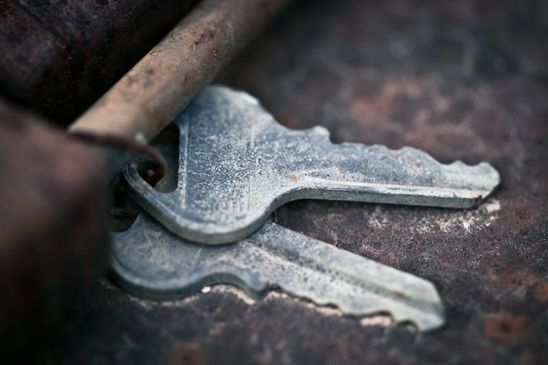 Corroding keys atop rusting metal.