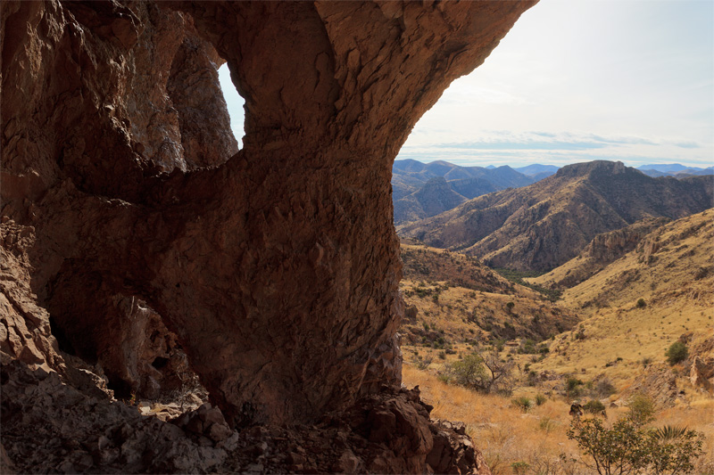 A view through and beside several natural windows high above Pothole and Horseshoe Canyons in the Chiricahua Mountains of Arizona.