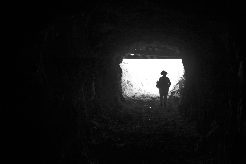 Standing at the entrance of a mine adit.