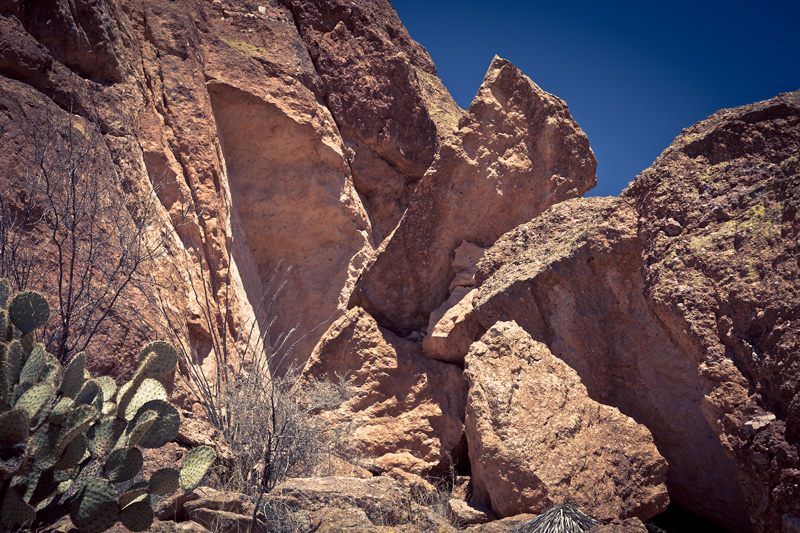 A wedge of rock fallen away from a cliff face.