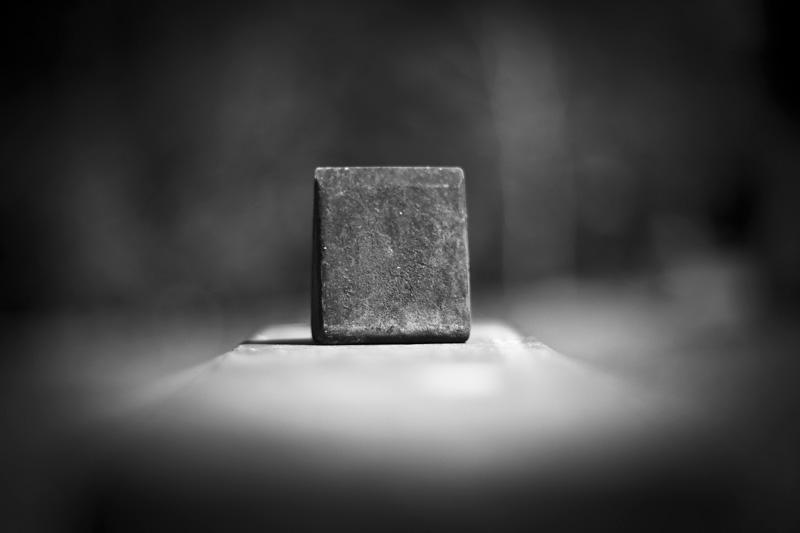 A metal cube atop a non-cube.